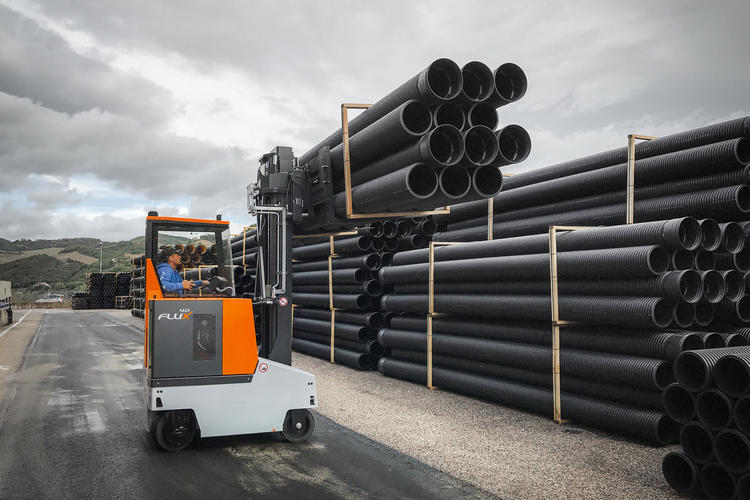 FluX transporting pipes in outdoor warehouse