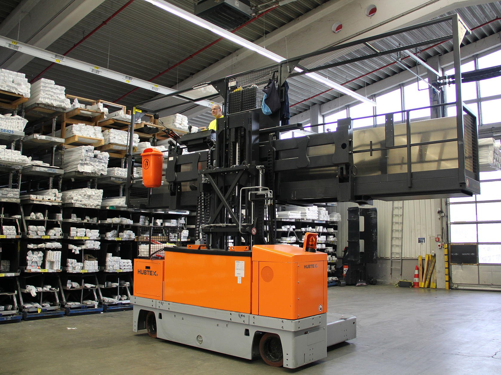 Electric multidirectional sideloader with attached order picking platform
